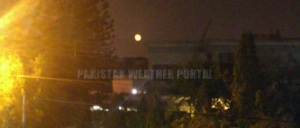 Orange Moon over the skies of Karachi